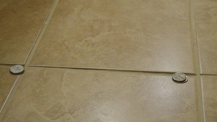 installation issue excessive tile lippage on floors closeup