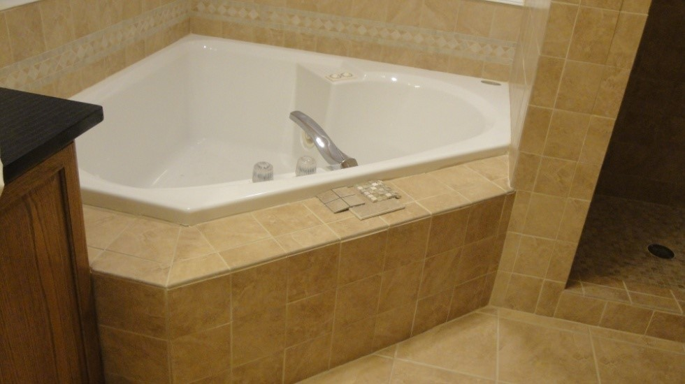 Installation Issue: Tub Surround Tiling and Shower Wall Tiles Were Not Set Straight