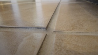 Horror tile installation: why bother with flat floors or evenly laid tiles?