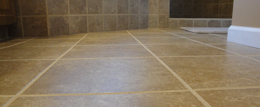 Certified Tile Installers lay flat tile floors