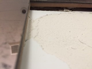 The tiles were tightly fitted with a butt joint. All tile installations must have a grout joint