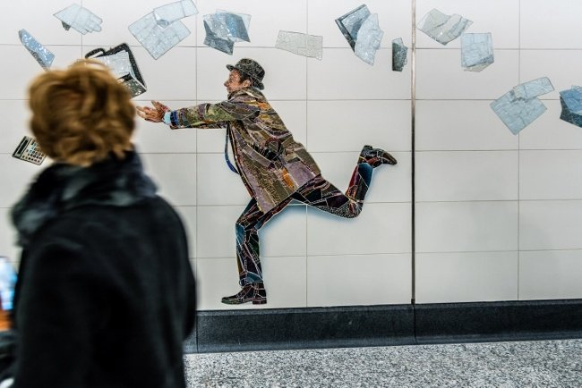 Artist Muniz includes himself in this Rockwell-like scene at the 72nd Street station.