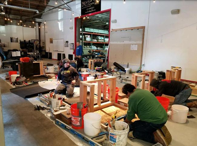 Brekhus tile installers hard at work during the CTI test.