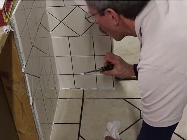 Scott checks for thinset or grout that may have been allowed to remain behind the sealant joint.