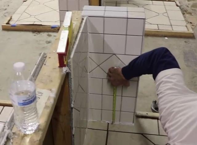 Scott checks the wall tile for balance.