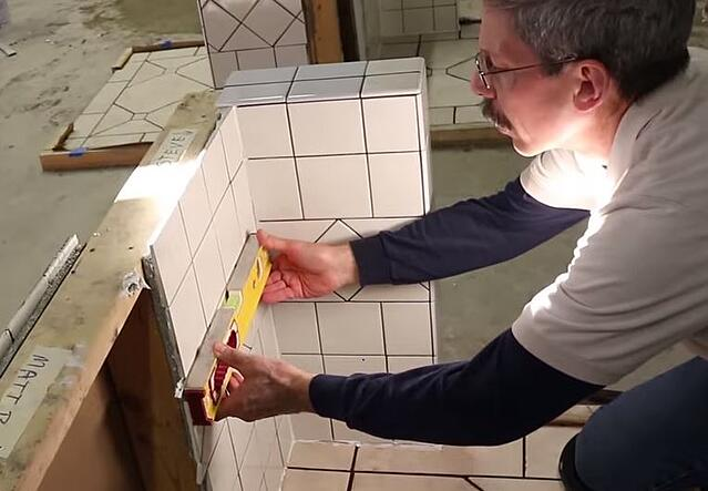 Scott checks the installation for both level and plumb on all three walls.