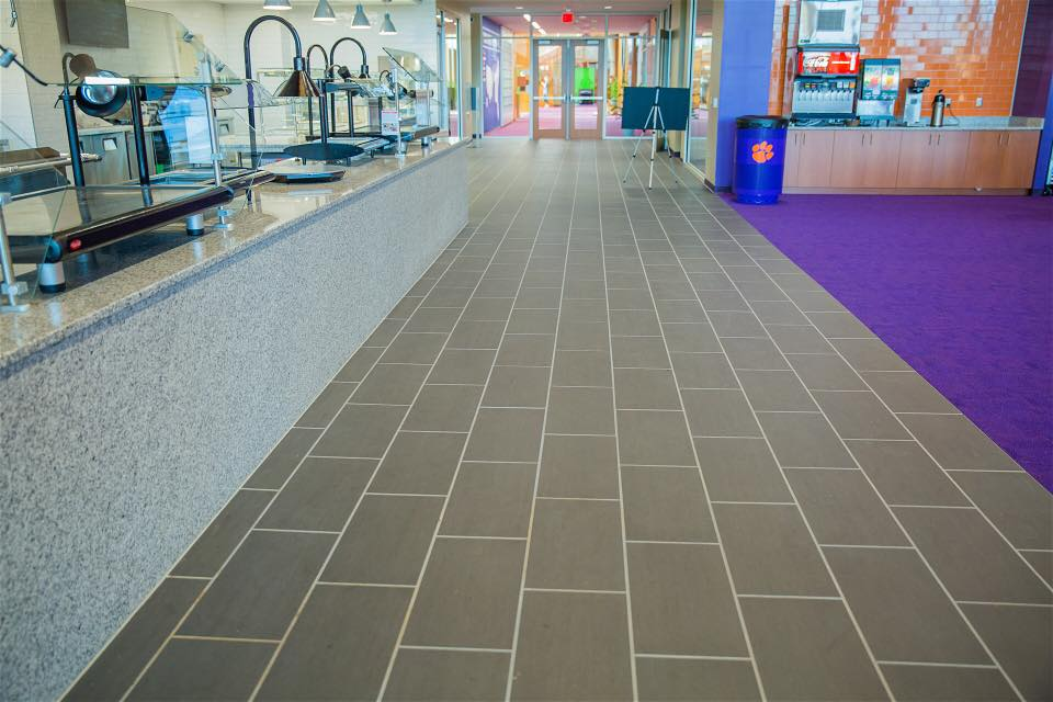 """Bill Griese calls attention to the 3/8"""" grout lines used throughout the wall and floor tile installations"""