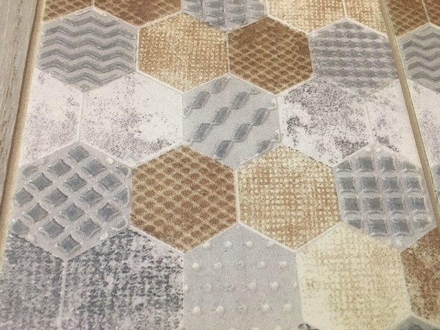 In this more raucous installation, all kinds of 3-D patterns in different colors create a patchwork of large hexagons.