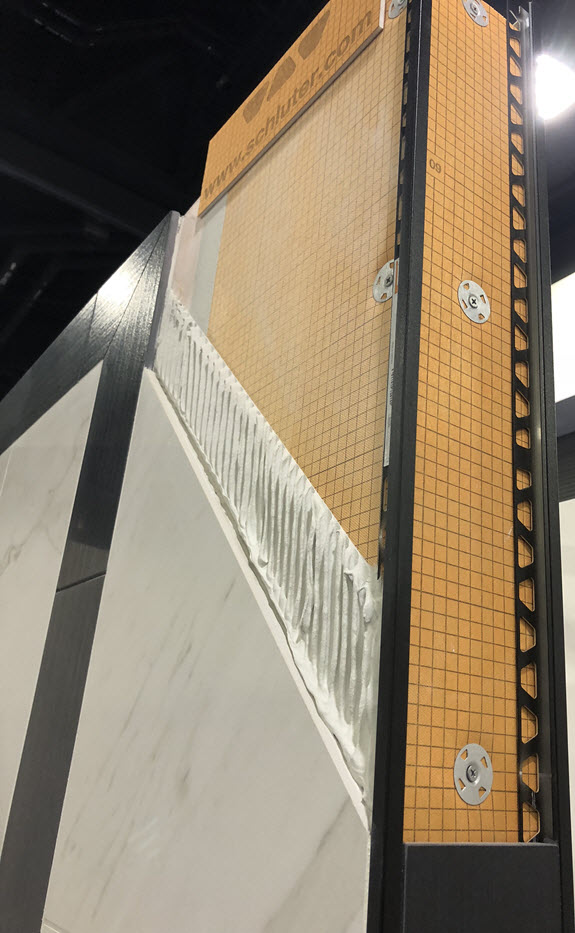 As you see in the cutaway below, a correct installation requires the proper backer board, waterproofing system, and mortaring (95% coverage in a wet area).