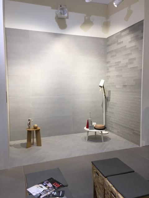 Here's a wall with considerable shade variation. It contrasts beautifully with the low-contrast large format wall tile, and the wood plank chevron floor pattern.