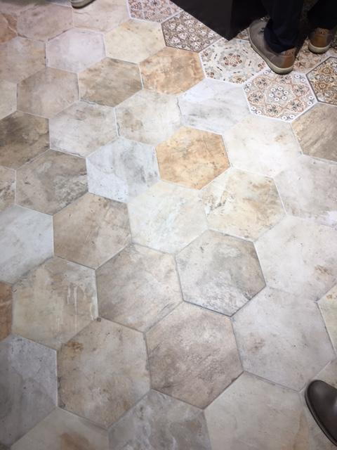 Here's a variety of hexagons - in different solid patterns with a traditional cement tile pattern patchwork.