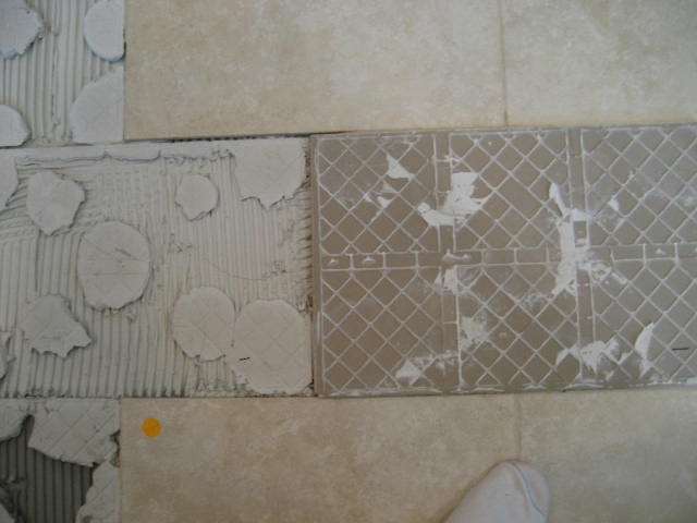 Spot bonding creates bare spots or voids under the tile