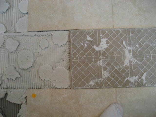 Spot bonding creates bare spots or voids under the tile