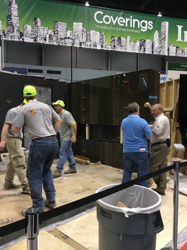 John Cox speaking with Nyle Wadford while the Welch Tile team (and Dan Welch) complete their 2016 Installation Design Showcase.