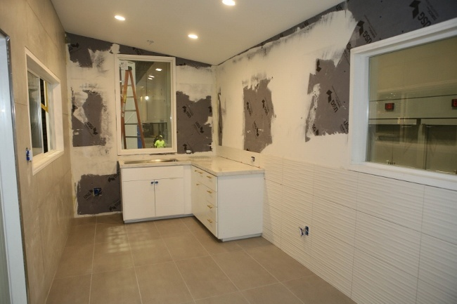 Notice the dimensional tile on the walls of the Retro Bungalow Tiny Home