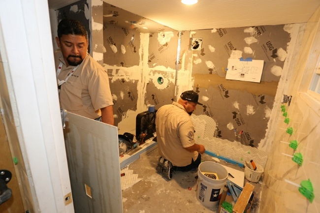 J&R Tile team working on the tiny house bathroom