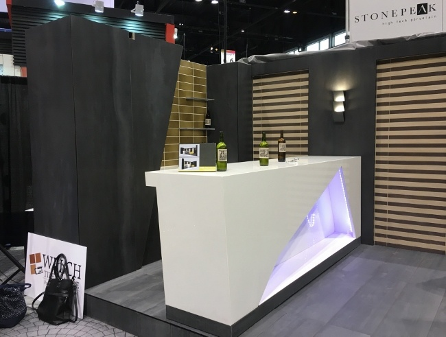 This bar features mitered cuts using thin porcelain large format tile