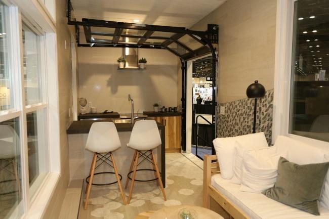 Vitruvian tiny house Garage Door Kitchen Feature Brings Outdoors In
