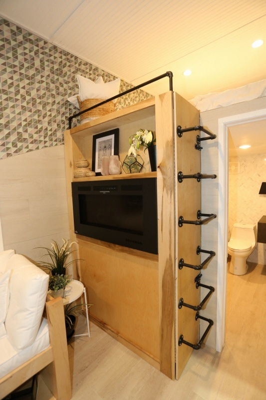 Multi-Purpose Functionality in Vitruvian Tiny House Living Space: storage