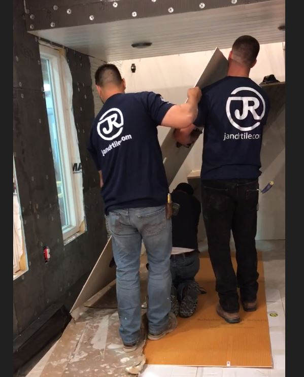 J&R Tile installing gauged porcelain tile panels in the tiny house.