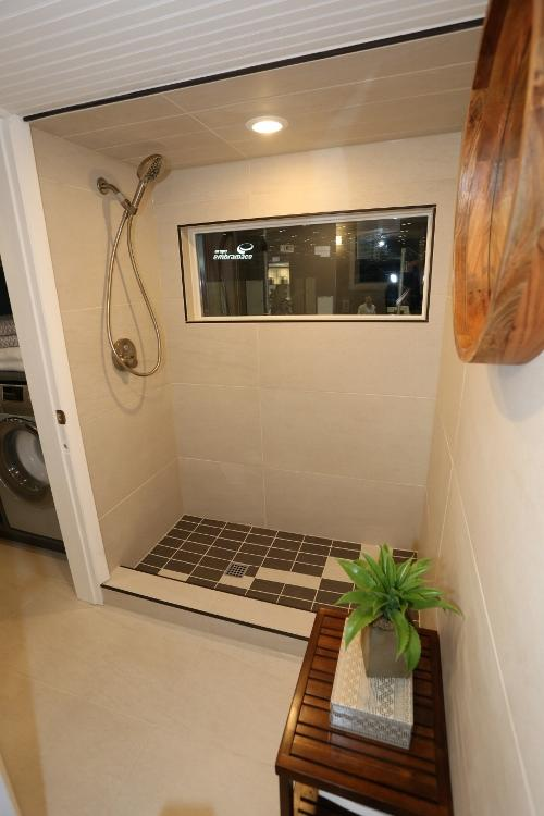 The finished tiled tiny house shower