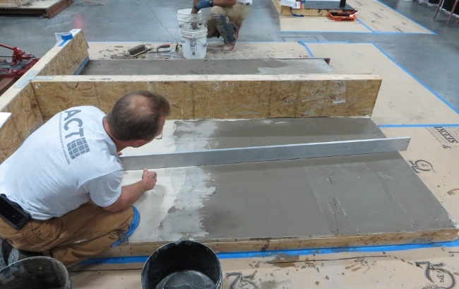 Use a long straightedge to determine if the trowel applied patch is flat enough for large format tile.