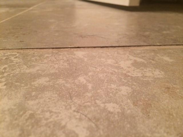 Who sets Tile Industry installation standards?