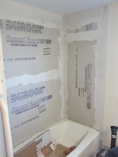 Properly waterproofing a tile shower: cement board layout with taped seams