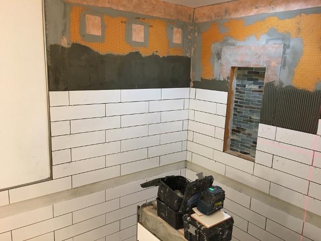 Wall shower tile installed on Schluter Kerdi Board