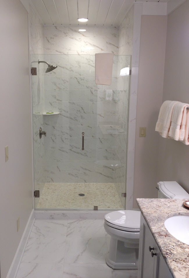 A full bathroom tile installation by Installations By Alex