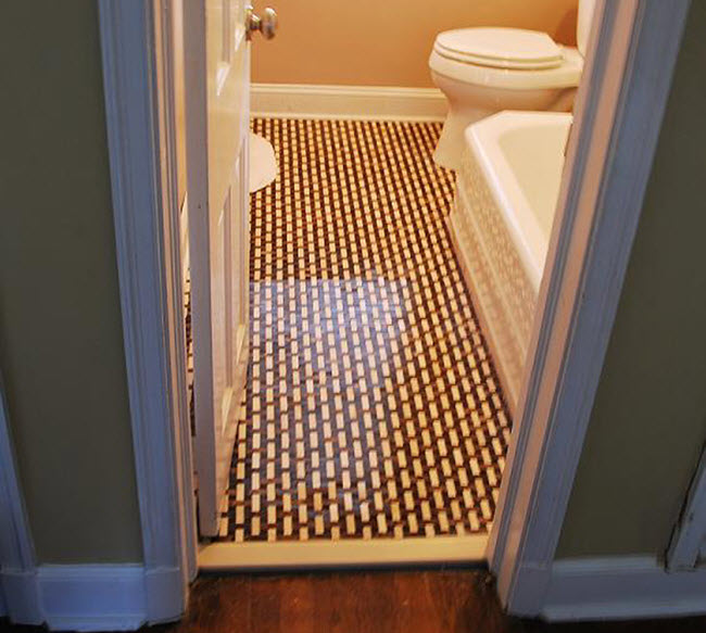 Bathroom tilework by Precision Tile Company and Scott Heron