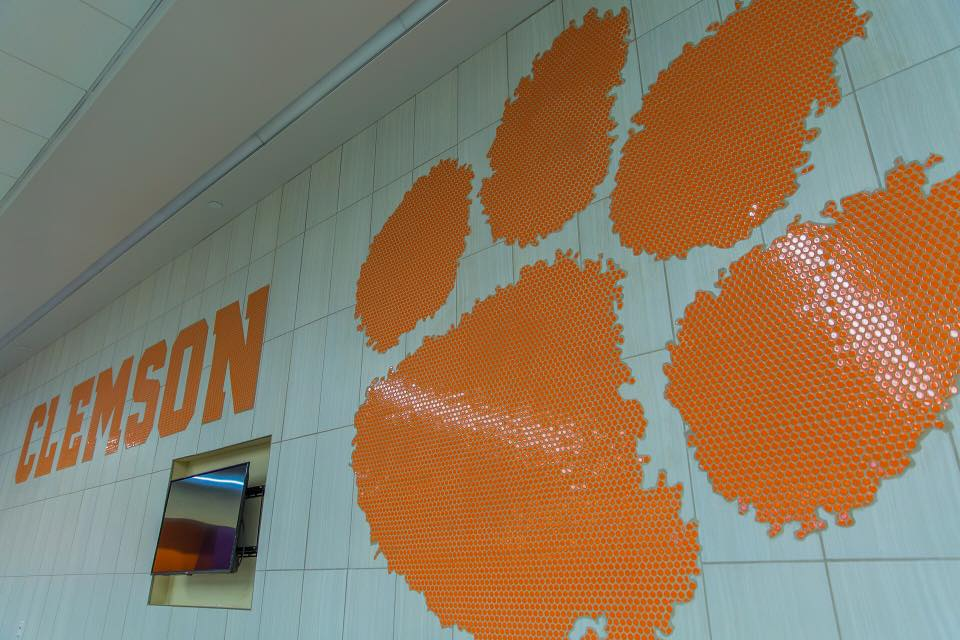 Notice the penny round mosaic wall treatment of the Clemson logo.