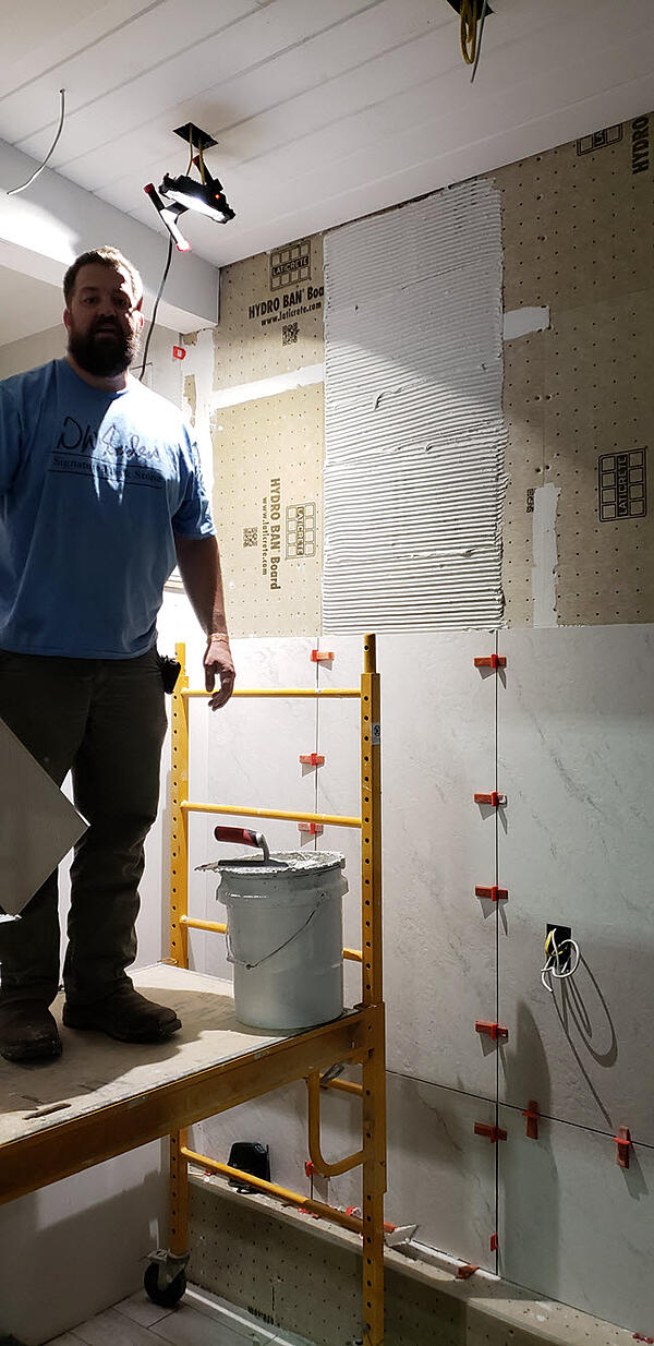 DWSanders-Coverings-3Challenges included ceiling heights and tiling every area of the tiny home.