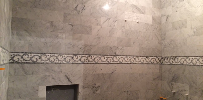 Detailed mosaic tile installation by Installations By Alex