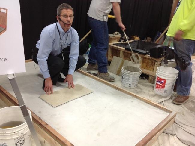 Scott Carothers demonstrating ceramic tile installation best practices.